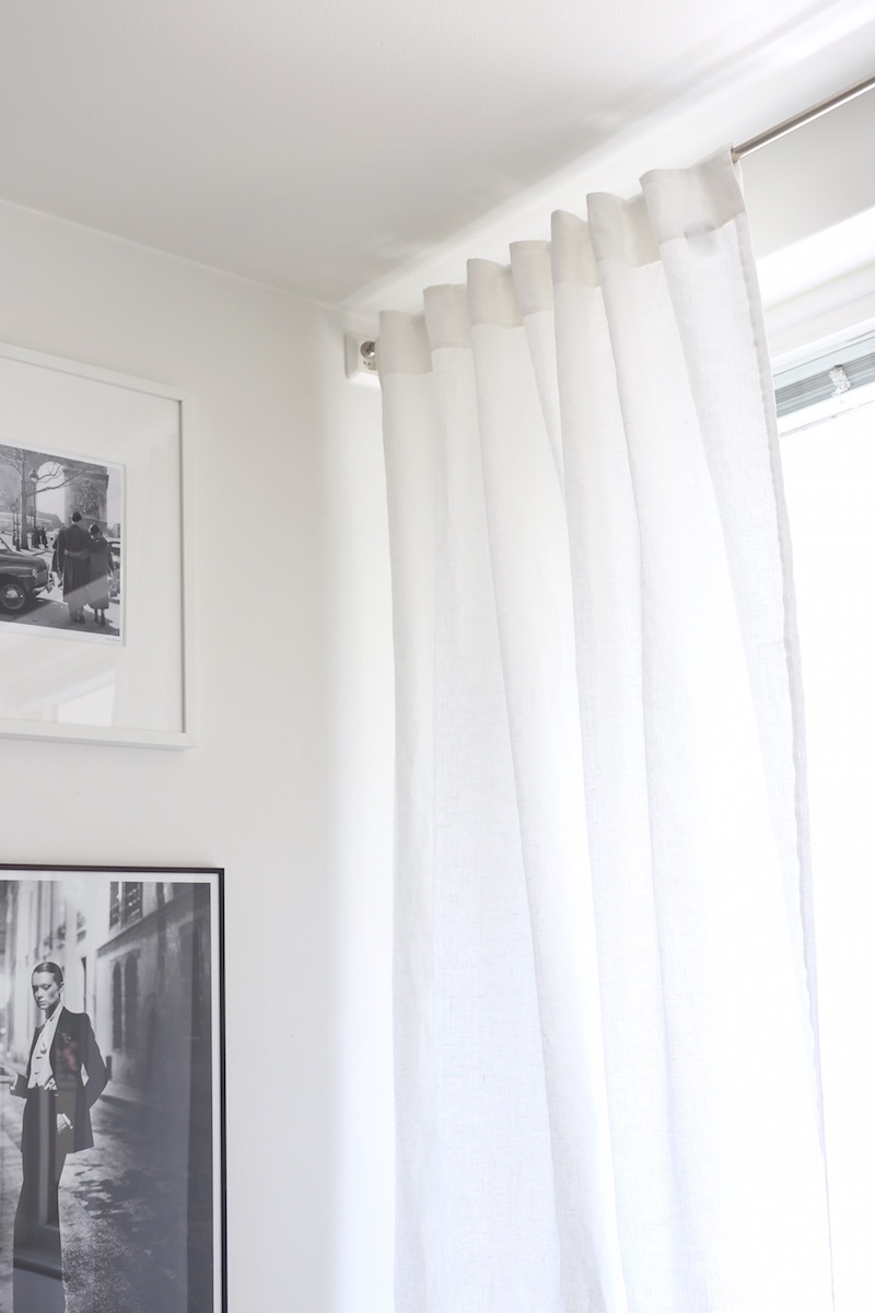 Homevialaura, olohuone, pellavaverhot, ikkunanpesu, tauluseinä